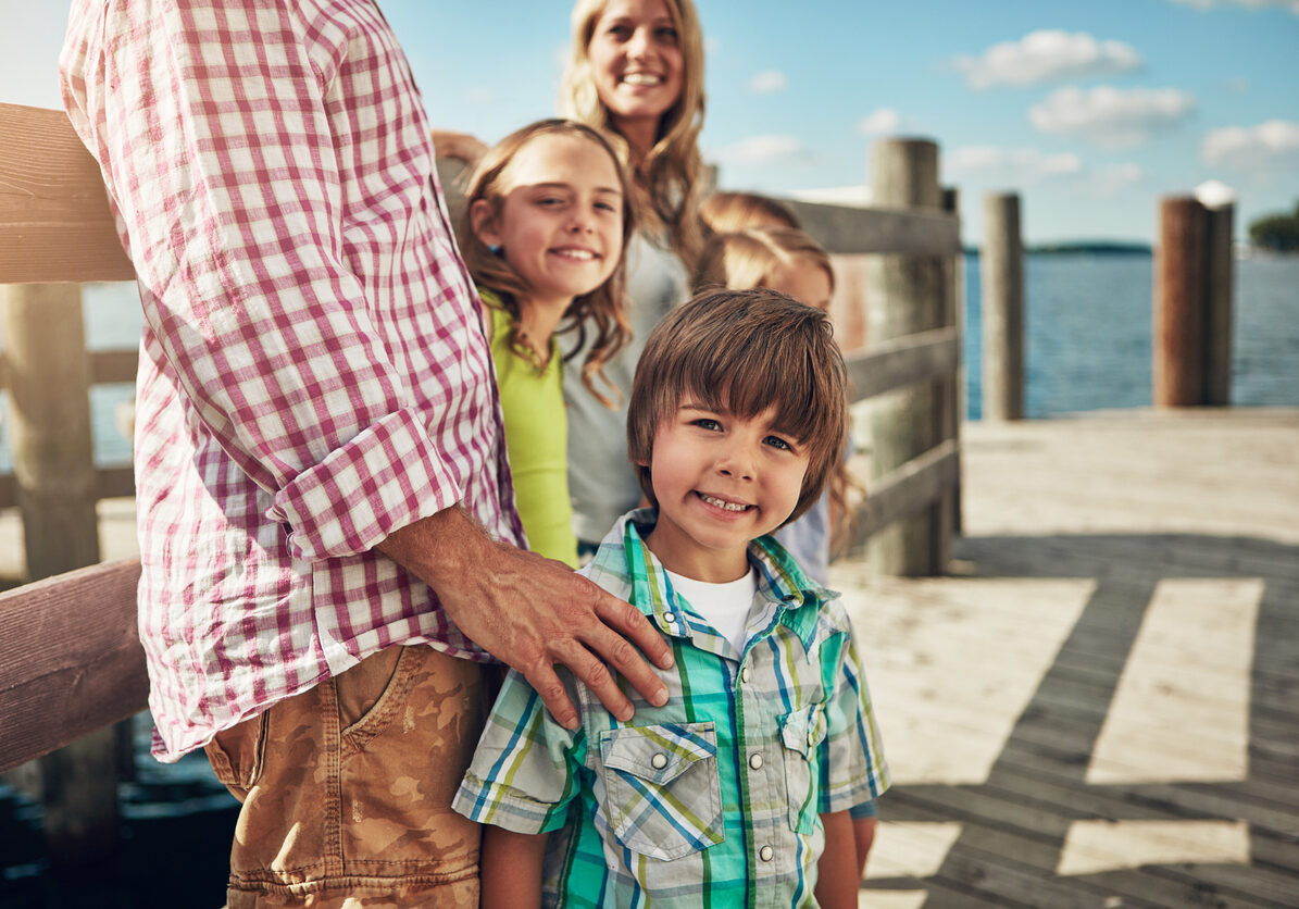 Shot of a young family on a pier while out by the lake
